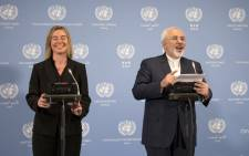 Iranian Foreign Minister Mohammad Javad Zarif (R) and EU foreign policy chief Federica Mogherini hold a press conference at the E3/EU 3 and Iran talks at the International Atomic Energy Agency headquarters in Vienna on 16 January 2016. Picture: AFP.
