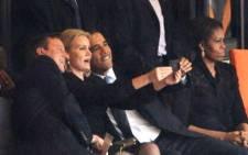 UK Prime Minister David Cameron and US President Barack Obama pose for a selfie with Danish Prime Minister Helle Thorning-Schmidt at Nelson Mandela's memorial service, FNB Stadium, 10 December 2013. Picture: AFP.
