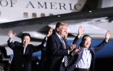 US President Donald Trump walks with the three Americans just released from North Korea, Kim Dong Chul, Kim Hak-song and Tony Kim at Joint Base Andrews on 9 May 2018 in Maryland. Picture: AFP