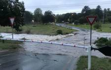 The Braamfontein Spruit along River Road in Bryanston overflows following heavy rains in the area. Picture: Supplied