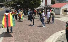 A handful of Zimbabwean nationals have gathered at the country's embassy in Cape Town to celebrate the leadership change in the country. Picture: Kevin Brandt/EWN.