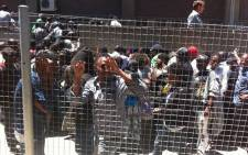 Asylum seekers waiting in long queues at the Home Affairs office in Cape Town. Police have been deployed to monitor the situation on 4 December 2014. Picture: Chanel September/EWN.