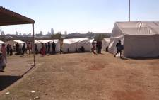 People evicted from Jeppestown are now staying at the Wembley Stadium in Joburg. Picture: Kgothatso Mogale/EWN