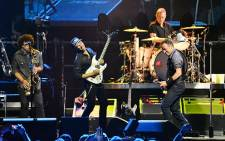 """Thousands of fans braved the pouring rain to watch Bruce Springsteen perform at FNB Stadium. Picture: Aletta Gardner/EWN"""""""