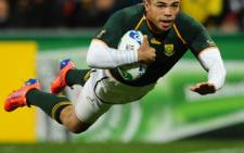 Springbok wing Bryan Habana scores a try during the 2011 Rugby World Cup pool D match against Namibia. Picture: AFP