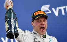 Mercedes's Finnish driver Valtteri Bottas celebrates on the podium after winning the Formula One Russian Grand Prix at the Sochi Autodrom circuit in Sochi on 30 April 2017. Picture: AFP.