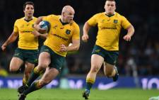 Wallabies hooker Stephen Moore runs with the ball during a Rugby Championship match. Picture: AFP