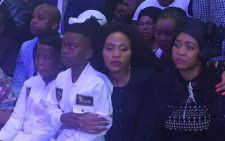 Sfiso Ncwane's wife Ayanda is pictured sitting with sister, Sbahle, and kids Umawenzokuhle & Ngcweti at a ceremony. Picture: Kgothatso Mogale/EWN.