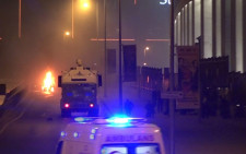 Ambulance and police arrive after a bomb exploded outside a stadium in Istanbul on 10 December, 2016. Picture: AFP.