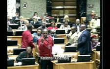 Economic Freedom Fighters Chief Whip Floyd Shivambu showing deputy president Cyril Ramaphosa middle finger in Parliament on 17 September 2014. Picture: Twitter - @Gareth EdwardsSA..