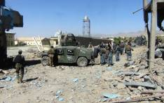 FILE: Afghan security personnel gather at the site of a suicide bombing attack on the police headquarters in Gardez, capital of Paktia province, on 18 June 2017. Picture: AFP