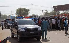FILE: This file photo shows emergency services, police and residents gather at the scene of a suicide bomb attack in Maiduguri, Nigeria. Picture: AFP.