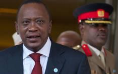 FILE: Kenyan President Uhuru Kenyatta leaves a hotel in London on 7 May 2013. Picture: AFP