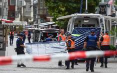 Swiss police arrive to set up a barrier at a crime scene in the old quarter of Schaffhausen, northern Switzerland on 24 July 2017, after a man armed with a chainsaw injured at least five people in an attack. Picture: AFP