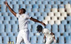 South African bowler Lungi Ngidi (L) celebrates the dismissal of Indian batsman and Captain Virat Kohli (R) during the fourth day of the second Test cricket match between South Africa and India at Supersport cricket ground on 16 January 2018 in Centurion. Picture: AFP.