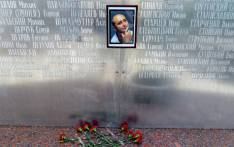 Flowers lay under a picture of the 41-year-old anti-Kremlin reporter Arkady Babchenko on the memorial wall of Moscow's journalists house in Moscow on 30 May 2018. Picture: Vasily Maximov/AFP