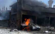 FILE: A handout image released by the official Syrian Arab News Agency on 5 May, 2016 shows a car burning at the site of a bomb attack in Mukharram al-Fawqani in Homs province. Picture: AFP.
