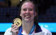 US Lilly King celebrates on the podium after the women's 100m breaststroke final during the swimming competition at the 2017 FINA World Championships in Budapest, on July 25, 2017. Picture: AFP
