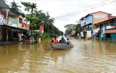 Sri Lankan residents travel by boat through floodwaters on May 27, 2017 in Kaduwela. Rainfall on May 26 triggered the worst flooding and landslides in 14 years in the southern and western parts of Sri Lanka, authorities said. The Disaster Management Centre (DMC) said 103 people were confirmed killed while another 113 were missing. Picture:  AFP.