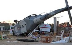 View of the remains of the military helicopter that fell on a van in Santiago Jamiltepec, Oaxaca state, Mexico, on 17 February 2018. Picture: AFP.