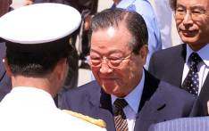 FILE: Former South Korean prime minister Kim Jong-Pil (C) is welcomed by Japanese officials upon his arrival at the Tokyo International Airport 01 September 1999. Picture: AFP