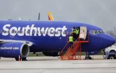 A Southwest Airlines jet sits on the runway at Philadelphia International Airport after it was forced to land with an engine failure, in Philadelphia, Pennsylvania, on 17 April 2018. Picture: AFP