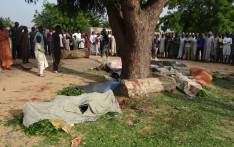 FILE: People gather on 12 July 2017 on the scene of an attack by suicide bombers in Maiduguri on July 11, 2017. Picture: AFP.