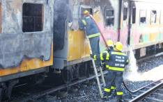 FILE: Firefighters extinguish a fire on a Metrorail train. Picture: Supplied