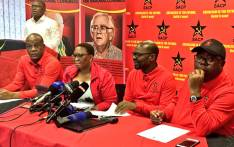 SACP's Solly Mapaila (second right) and party members addressing the media after President Jacob Zuma announced changes to his Cabinet on 17 October 2017. Picture: Katleho Sekhotho/EWN.