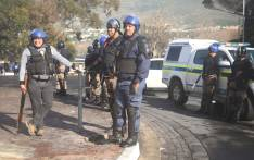FILE: This file photo shows public order police as they watch a crowd of protesters in Imizamo Yethu. Picture: Bertram Malgas/EWN