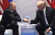 FILE: US President Donald Trump and Russia's President Vladimir Putin shake hands during a meeting on the sidelines of the G20 Summit in Hamburg, Germany, on 7 July 2017. Picture: AFP.