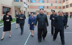 This undated picture released from North Korea's official Korean Central News Agency (KCNA) on October 19, 2017 shows North Korean leader Kim Jong-Un (C) visiting the Ryuwon Footwear Factory in Pyongyang. Picture: AFP VIA KNS.
