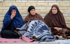 Relatives of the victims of the bomb and gun assault on the North Sinai Rawda mosque sit outside the Suez Canal University hospital in the eastern port city of Ismailia on 25 November 2017, where they were taken to receive treatment following the deadly attack the day before. Picture: AFP.