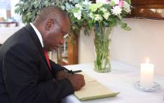 Deputy President Cyril Ramaphosa signs the condolences book at Kathrada's home in Killarney. Picture: Christa Eybers/EWN.