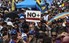 Venezuelan opposition activists protest against the government of President Nicolas Maduro, in Caracas, on May 15, 2017. Picture: AFP