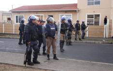 FILE: Police monitor the Parkwood area as residents protest for land. Picture: Bertram Malgas/EWN.