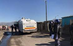 Police on the scene in Phumlani Village informal settlement after protests turned violent on 27 July, 2017. Picture: Monique Mortlock/EWN
