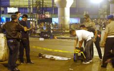 Indonesian police officers and investigators place police tape at a bus terminal in Jakarta after a bomb blast on 24 May 2017. Picture: AFP.