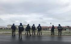 Violence flared up after structures illegally erected on an open field along the M5 expressway were demolished by authorities. Picture: Cindy Archillies/EWN