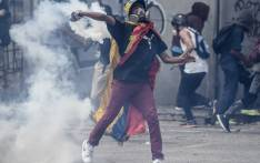 An opposition activist clashes with the police during a march towards the Supreme Court of Justice (TSJ) in an offensive against President Maduro and his call for Constituent Assembly in Caracas on 22 July 2017. Picture: AFP