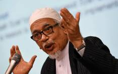File: Hadi Awang, president of opposition Pan-Malaysia Islamic party (PAS), gestures during a lecture at S. Rajaratnam School of International Studies (RSIS) in Singapore on 28 April, 2015. Picture: AFP.