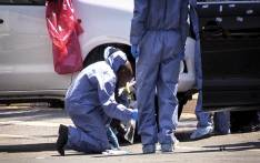 "FILE: A forensic team member combs the scene where Lebanese drug dealer Sam ""Black"" Issa was gunned down in a drive-by shooting in Bedfordview on 12 October 2013. Picture: Reinart Toerien/EWN."