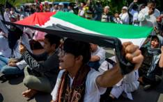 Indonesian protesters shout slogans while holding a Palestinian flag during a protest in front of the US embassy in Jakarta on 8 December, 2017, against US President Donald Trump's recognition of Jerusalem as Israel's capital. Picture: AFP