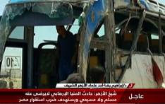 An image grab taken from Egypt's state-run Nile News TV channel on 26 May 2017 shows people inspecting the remains of a bus that was attacked while carrying Egyptian Christians in Minya province, some 260 km south of Cairo. Picture: AFP.