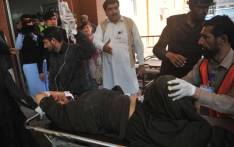Pakistani volunteers move a blast victim to a hospital in Peshawar on 21 February, 2017, after multiple Taliban suicide bombings at a court complex in the Tangi area of Charsadda district. Picture: AFP.