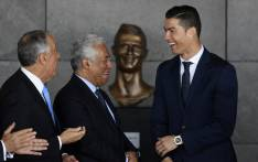 Cristiano Ronaldo (R), Portuguese PM Antonio Costa and Portuguese President Marcelo Rebelo de Sousa take part in a ceremony where Madeira's airport in Funchal was renamed after Cristiano Ronaldo. Picture: AFP.