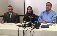 Renisha Jimmy (centre), sister of the late Reshall Jimmy, family attorney (left) and forensic pathologist David Klatzow (right) brief the media on a settlement offer from Ford in Pretoria on 24 May 2017. Picture: Reinart Toerien/EWN.