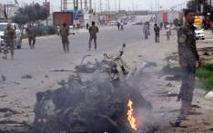 Iraqi security secure the area of a car bomb on March 16, 2013, in the northern city of Kirkuk, which injured some 18 people. Picture: AFP/ MARWAN IBRAHIM