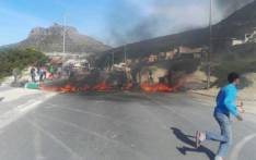 About 50 protesters placed burning debris and other material in the middle of the road in Hout Bay on 18 August 2017. Picture: City of Cape Town