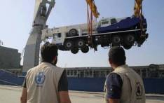 One of the four mobile cranes arrives in the important Houthi-controlled Hodeidah port. Picture: @WFP_MENA/Twitter.